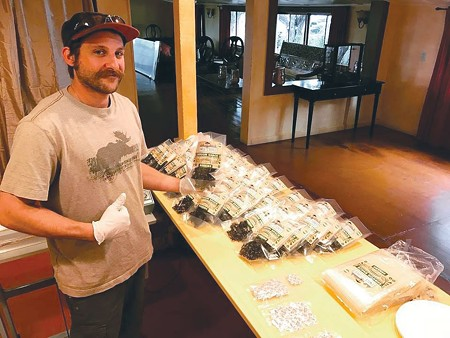 MEATLESS WONDER Hunter Bryson packages the first batch of Shroom Jerky.