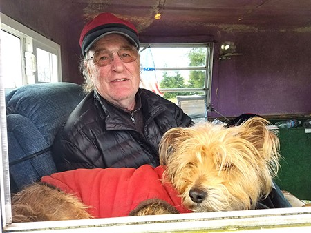 ROAD SCHOLAR  Greg Brummett has been selling his smoked salmon along West County roads for 35 years. Always with a cute dog, too.