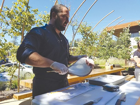 FISH MONGER  Water2Table chef Ben Spiegel demonstrates how to fillet a California halibut at Handline restaurant.