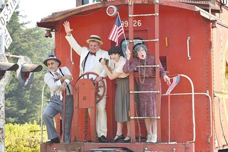 HATE TRAIN Neil Thollander (center) stars as demagogue Berzelius Windrip in 'It Can't Happen Here.'