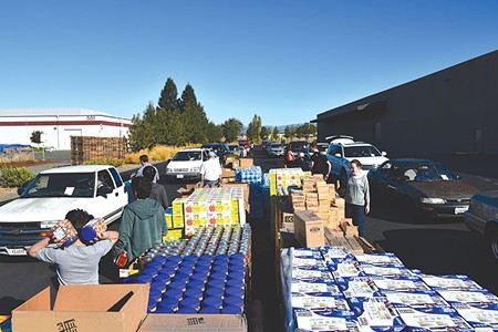DRIVE THRU  In the first two weeks of the fires, the Redwood Empire Food Bank delivered 1 million pounds of food.