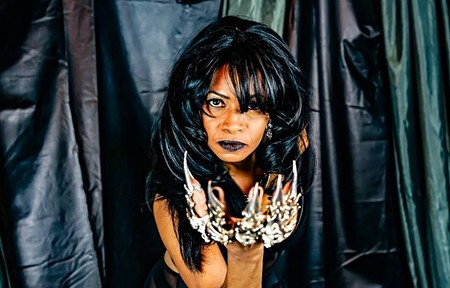 STAY DANGEROUS  Military veteran and grandmother Kenyetta Todd combines costume design and burlesque - when she performs as Dangerous Dollie.