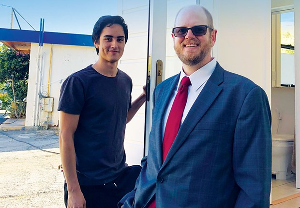 Owen Navarro of San Rafael stands beside Sean Ticknor, president and founder of Big Skills Tiny Homes. - PHOTO BY  ROBERT BROWN.