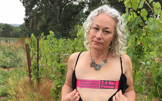 Nichole Warwick, a breast cancer survivor and Sonoma County environmental activist. The words on her chest read: 'Pesticides used in Sonoma County Annually for Wine 2.3 million pounds.' - PHOTO BY JONAH RASKIN