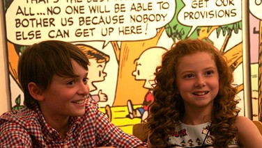 Noah Schnapp (Charlie Brown) and Francesca Capaldi (Little Red-Haired Girl) are all smiles at the Charles M Schulz Museum