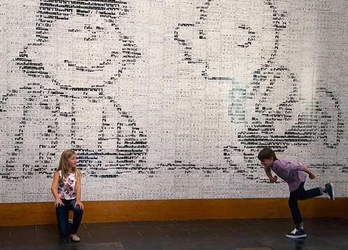 Peanuts Movie cast members Hadley Belle Miller (Lucy) and Noah Schnapp (Charlie Brown) recreate the iconic football kick in front of a mural at the Charles M Schulz Museum.