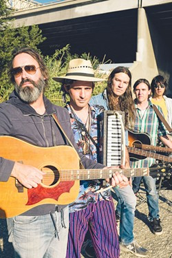 THIS AND THAT Skiffle is unpredictable, cobbled together and fun, says Farmer Dave Scher, center.
