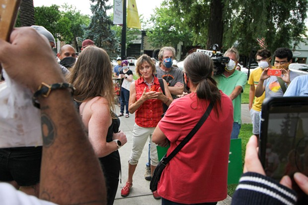 Healdsburg Mayor Leah Gold speaks with constituents at a protest on June 11, 2020.