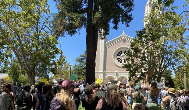 Hundreds of protesters crowded the St. Vincent's Church Plaza on Sunday as part of a demonstration organized by St. Vincent's High School alum Aidan Lynch and local Black Lives Matter supporters.