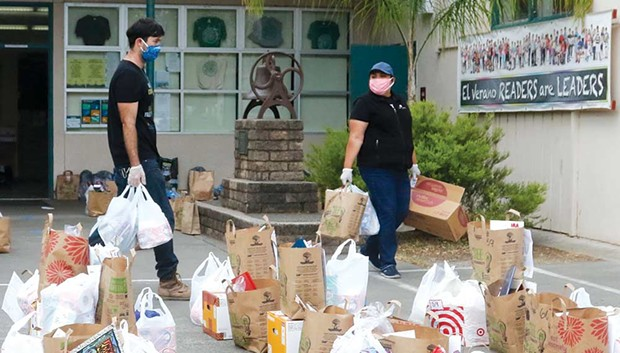 Volunteers prepare bags for delivery to families in Southeast Sonoma County.