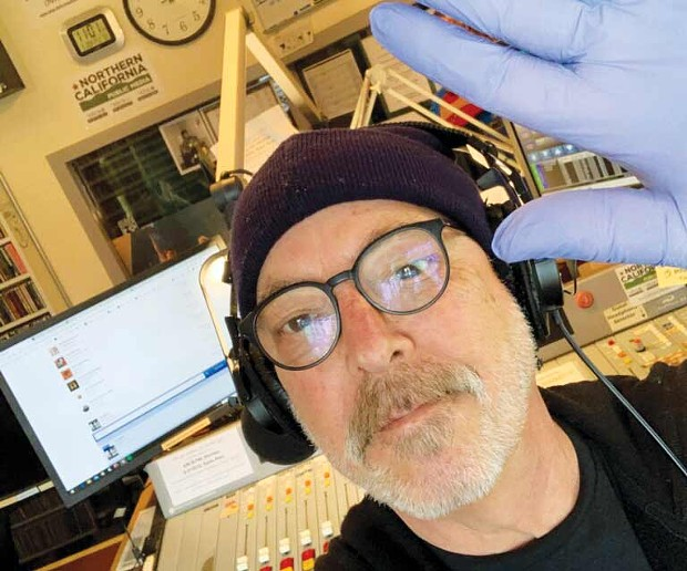 STUDIO SELFIE  Radio DJ Brian Griffith mans the board at KRCB with extra precaution. Credit: Photo courtesy Brian Griffith