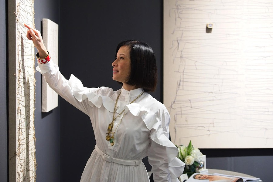 Actor and artist Lucy Liu visits her exhibit at the Napa Valley Museum in February. - LOWELL DOWNEY