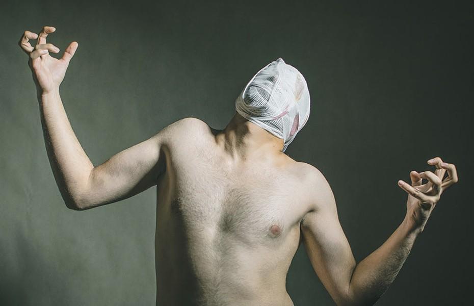 The 'Invisible Man' undresses. - PHOTO BY ARMIN LOFTI