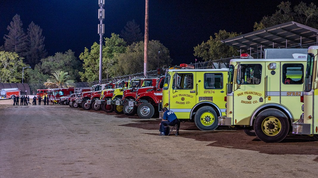 Firetrucks wait to be deployed at a Calistoga basecamp on Aug. 24, 2020, in this photo; part of Napa Valley Museum's latest exhibit. - TIM CARL