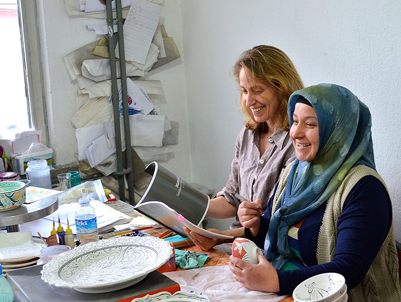A SENSE OF PLACE  Mimi Robinson, left, worked with artists in Kütahya, Turkey, to help bring their work to market. - TED BARBER