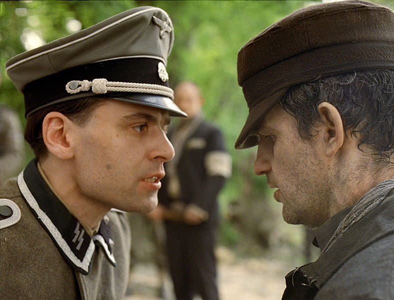 FACES OF WAR Géza Röhrig, right, plays an Auschwitz prisoner reawakened to life in Holocaust film from first-time director.
