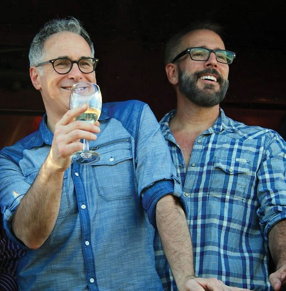 OUT STANDING Gary Saperstein, left, and Mark Vogler founded Out in the Vineyard to bring gay tourists to wine country.