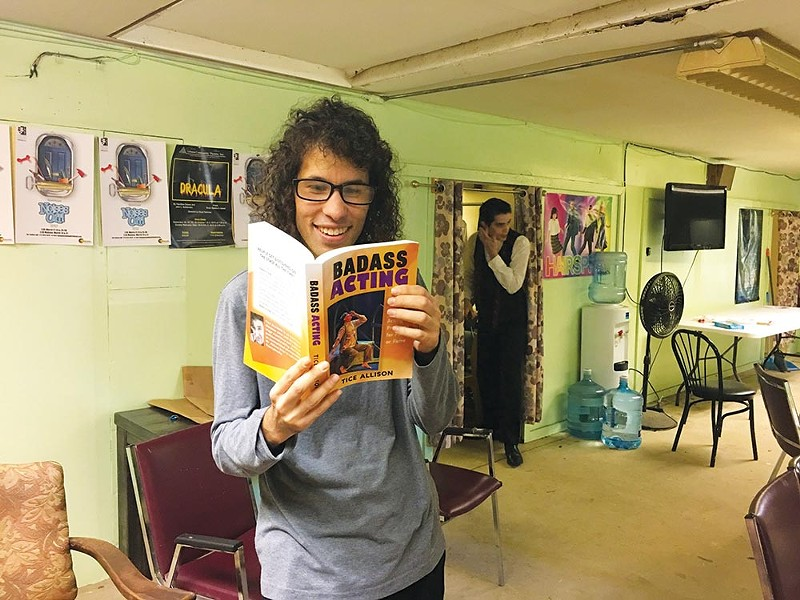 Actors backstage at a local theater take time out to browse Tice Allison's 'Badass Acting.'