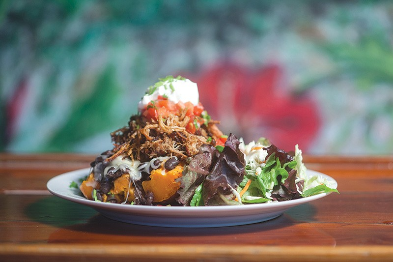 HOT POTATO Smoky, pork-topped yams are one of the signature dishes at Papas and Pollo. - MICHAEL AMSLER