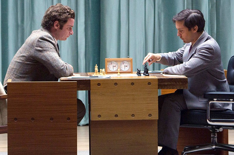 WAR GAMES Bobby Fischer, played by Toby Maguire, right, was a chess genius and a real jerk.