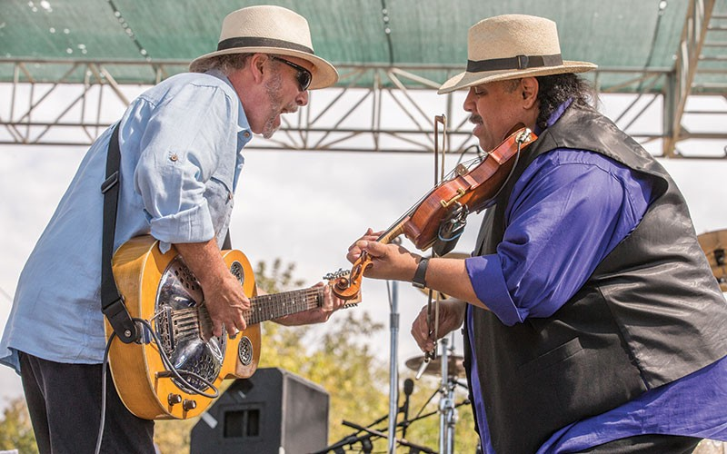 THEY GOT RHYTHM Roy Rogers & the Delta Rhythm Kings lay down a tune at the festival's outdoor stage. - STERLING MUNKSGARD