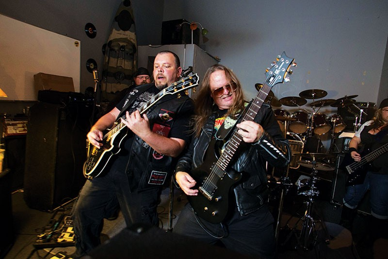 THE AX MEN COMETH  Lance Ozanix (right) shreds alongside newest Skitzo member Jason Wright at the band's rehearsal space. - MICHAEL AMSLER