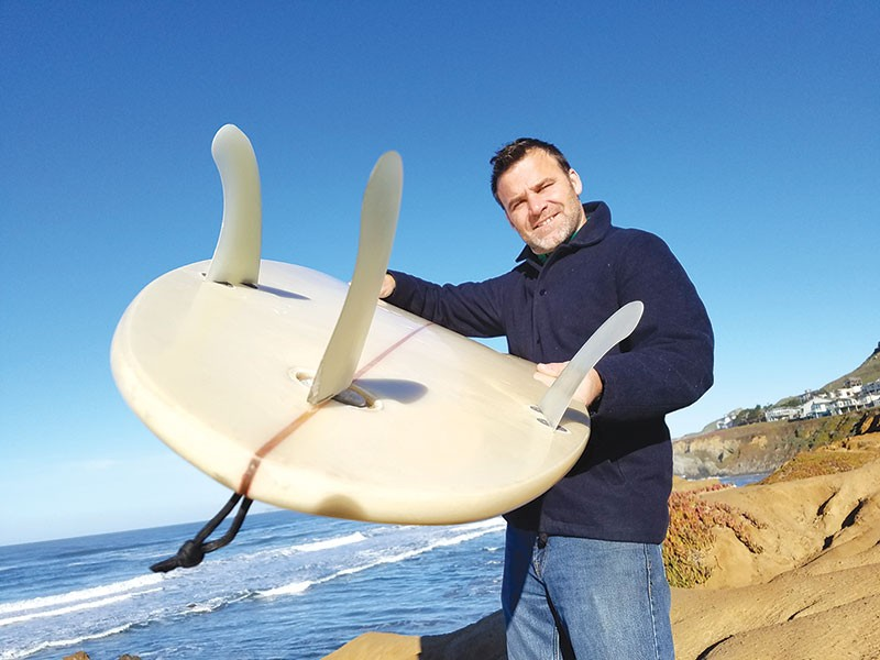 A BETTER MOUSETRAP?  Klaus Dilling's TunaFin pivots the center fin via a foot-driven tiller to align it with the side fin making a turn, a design he says boosts a surfer's performance.