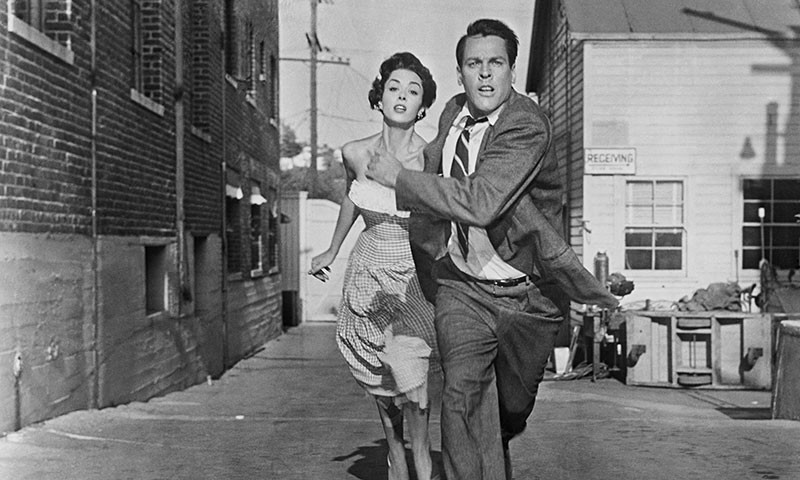 RUN AWAY, RUN AWAY!  Dana Wynter and Kevin McCarthy respond calmly and collectedly - in the original 1956 'Body Snatchers.'