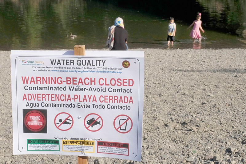 BEACH CLOSED  Sonoma County officials warned the public to avoid contact with the water at Monte Rio Beach, - but it didn't stop these kids from getting wet. - RORY MCNAMARA