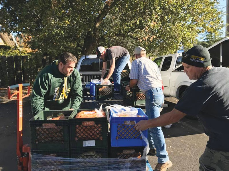 PASTA SQUAD  Volunteers A. J. Reibli, Jess Wade, Bob Rey and Scooter McAllister unload - food received from Facebook - chefs at Vella Cheese Company - in Sonoma. - JAMES FANUCCHI