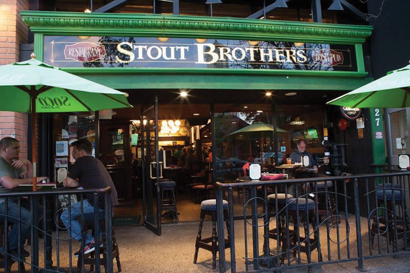 NOVEL IDEAThere's nothing like kicking back with a Guinness and a good book at Stout Brothers.</ - COURTESY CHANDI HOSPITALITY GROUP