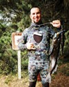 <b>SHAKA AND A SMILE</b> You'd be hanging loose, too, if you had a stringer of lingcod like spearfisherman and Seals Watersports manager Zeke Cissell.