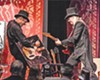 <b>GUITARS AND CANVAS</b>  Neal Barbosa (left) joins musicians like Danny Click onstage to paint when they play  this weekend at Italian Street Painting Marin in San Rafael.