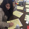 Lupe Maldonado helps evacuees as a bilingual translator at the Petaluma Fairgrounds shelter.