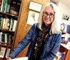 <p><b>BOOKED</b> The Botanical Dimensions Ethnobotany Library founder Kathleen Harrison looks through 'History of Sonoma County' by Honoria Tuomey.</p>