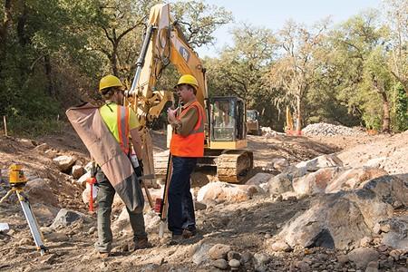 UPSTREAM BATTLE Sonoma Land Trust's Tony Nelson, right, directs work on a Stuart Creek steelhead habitat project. - SONOMA LAND TRUST/LANCE KUEHNE PHOTOGRAPH