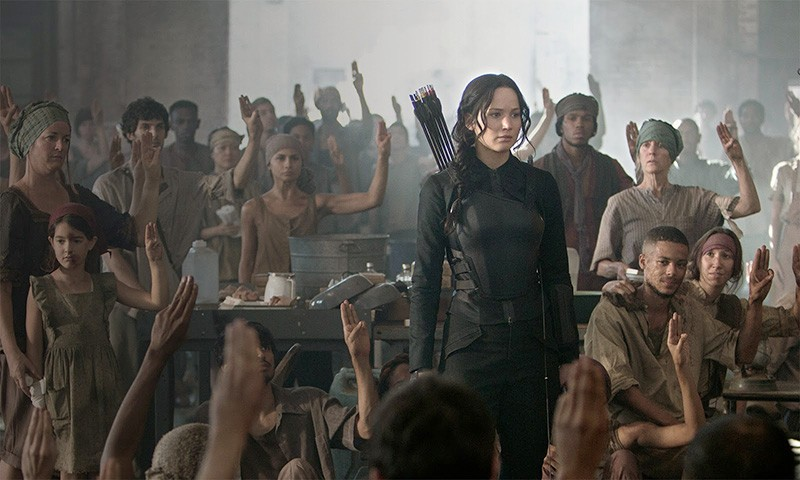 WHO'S READY FOR THE NEXT 'HUNGER GAMES' MOVIE? Katniss (Jennifer Lawrence) rallies the masses as a guerrilla war against Panem heats up.