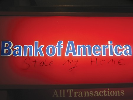 WITHDRAWAL Graffiti on a downtown Santa Rosa ATM echoes the bank's recent settlements for mortgage violations.