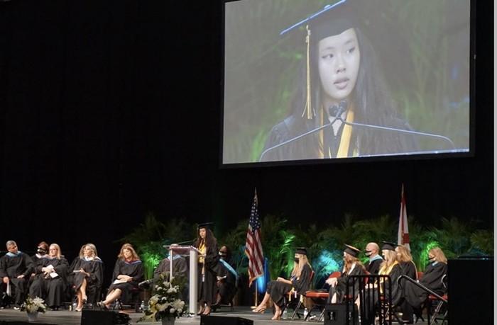 Rachel Cheng delivers her salutatorian speech at the BB&T Center in Sunrise on June 8. - COURTESY OF RACHEL CHENG