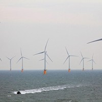A boat approaches part of the Thanet Wind Farm in the North Sea.