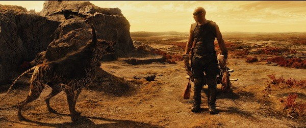 A BOY AND HIS DOG: Our hero (Vin Diesel) makes a friend in Riddick. (Photo: Universal)