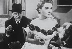 20TH CENTURY FOX - A CRITIC'S PERSPECTIVE: Theater scribe Addison DeWitt (George Sanders) scrutinizes actress Eve Harrington (Anne Baxter) in All About Eve.