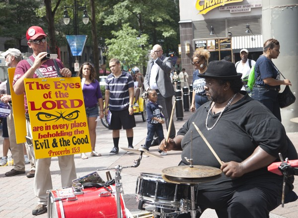 A jazz band played at the intersection of Tryon and Trade streets as protesters made their way toward the convention.