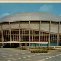 "A vintage postcard describes the Charlotte Coliseum, now Bojangles' Coliseum, as ""futuristic"" and ""spacious."""