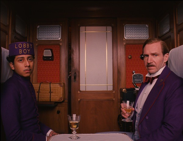 A WILD RIDE: Tony Revolori and Ralph Fiennes in The Grand Budapest Hotel. (Photo: Fox Searchlight)