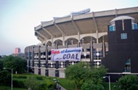Activists dangle 70-foot banner off BofA stadium