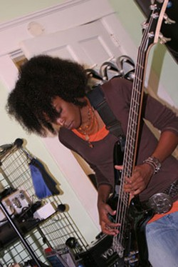 Adrienne funks it up on the bass. - CATALINA KULCZAR