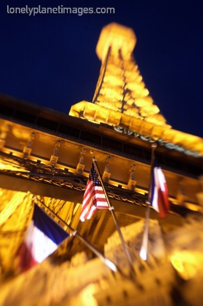 American and  French flags fly at the Eiffel Tower    Image by Lonelyplanetimages.com