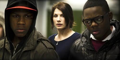 ANARCHY IN THE U.K.: Moses (John Boyega), Sam (Jodie Whittaker) and Jerome (Leeon Jones) confront an alien invasion in Attack the Block. (Matt NettHeim / Screen Gems)