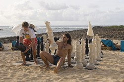 GLEN WILSON / UNIVERSAL - ASSUME THE POSITION: Aldous (Russell Brand, right) teaches Donald (Jack McBrayer) how to use his piece in Forgetting Sarah Marshall.